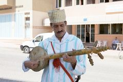 Singer. Taroudant, Morocco: street singer and musician is playing a traditional berber guitar Royalty Free Stock Photography