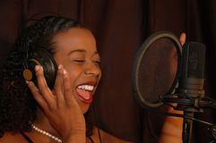 Singer. In studio Royalty Free Stock Image