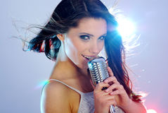 Singer. Girl Singing In Retro Mic on stage Royalty Free Stock Photography