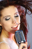 Singer. Girl Singing In Retro Mic on stage Stock Image