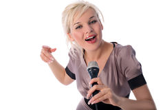 Singer. Lovely blondie girl singer with mic isolated on white Royalty Free Stock Images