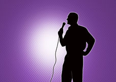 Singer. There is a silhouette of the person holding a microphone and singing song Stock Photography