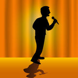The singer. Vector illustrated silhouette of a singer on stage with orange background Stock Photo
