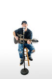 Singer Acoustic Guitarist  on White with hat Royalty Free Stock Images
