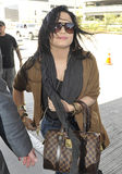Singer actress Demi Lovato at LAX airport. LOS ANGELES-APRIL 15: Singer actress Demi Lovato at LAX airport. April 15 in Los Angeles, California 2011 Stock Images