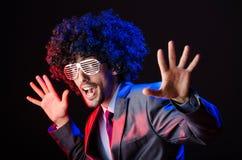 Singer with afro cut. In dark studio Stock Photo