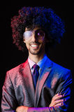 Singer with afro cut. In dark studio Royalty Free Stock Photography