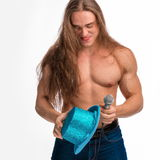 Singer bodybuilder shirtless with long hair in a blue hat with a microphone Royalty Free Stock Photos