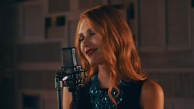 Singer with bright make up perform on stage at concert microphone. Jazz. Retro. Style. Dance stock footage