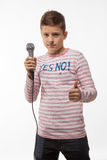 Singer brunette boy in a pink jumper with a microphone. On a white background Stock Photography