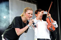 The singer of Clean Bandit (British electronic group) and the violinist takes a picture with his smartphone at Primavera Pop Festi Stock Photos
