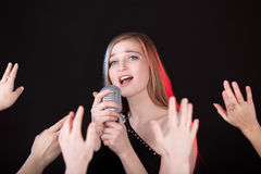 Singer in crowd Royalty Free Stock Images