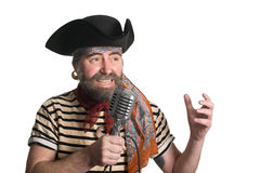 Singer dressed as pirate sings  microphone. Singer dressed as sea pirate sings in an old microphone Royalty Free Stock Image
