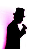 Singer emcee in top hat Stock Photo