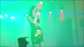 Singer girl brunette sings blurred concert night beautiful light with microphone. slow motion video. Singer in stock video