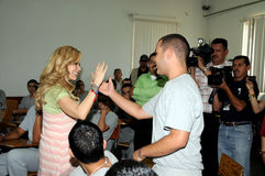 Singer Gloria Trevi giving five to inmate Royalty Free Stock Photography