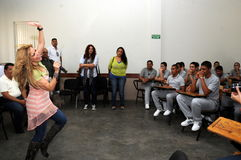 Singer Gloria Trevi performing for inmates. Singer Gloria Trevi is singing and dancing in front of teenage prisioners Royalty Free Stock Photo