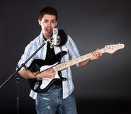 Singer with guitar Royalty Free Stock Photos