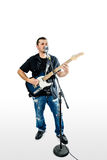 Singer Guitarist  on White lean back Royalty Free Stock Photo