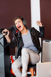 Singer Having Fun While Singing In Recording Studio Stock Image