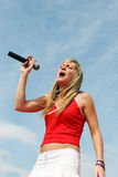 Singer hits the high notes Stock Images