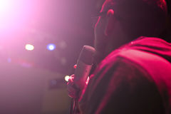 Singer holding a microphone and singing Royalty Free Stock Image