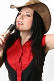 Singer, Host, Presenter. Woman in western attire using a microphone. Eg sisnger, presenter, host, Master of ceremonisc (MC Royalty Free Stock Image