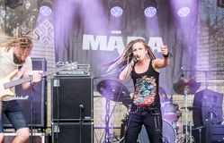 Singer Māra Lisenko of Latvian metal band Māra. Jekabpils, Latvia - August 4, 2018: Singer Māra Lisenko of Latvian metal band Māra performing at royalty free stock photos