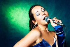Singer with a microphone Royalty Free Stock Photo