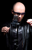 The singer from the microphone. On a black background Royalty Free Stock Photography