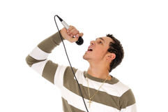 Singer with microphone. Side portrait of young male singer with microphone, isolated on white background Royalty Free Stock Image