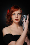 Singer with a microphone Royalty Free Stock Photography
