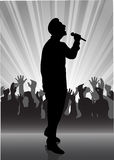 Singer at the microphone. On the image the performer with a microphone on a scene is presented Royalty Free Stock Image