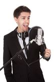 Singer and microphone. Young singer and microphone. Isolated on white Stock Photo
