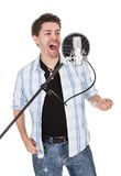 Singer and microphone Stock Images