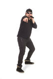 Singer with the microphone. Man is singing with the microphone in the dark glasses Royalty Free Stock Image
