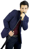 Singer with microphone smiling. Happy Singer with microphone smiling into camera Stock Photos