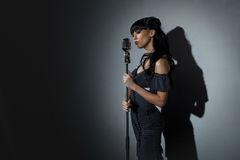 Singer with microphone Royalty Free Stock Image