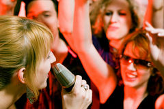 Singer performing in front of crowd Royalty Free Stock Photography