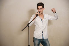 A singer is performing. A singer in performing next in a vintage room Stock Photography