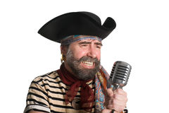 Singer pirate sings in an old microphone. Singer dressed as pirate sings in an old microphone Stock Photography