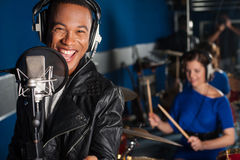 Singer recording a song in studio stock image