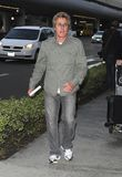 Singer Roger Daltry from The Who at LAX. LOS ANGELES-JUNE 17: Singer Roger Daltry from The Who is seen at LAX. June 17th 2010 in Los Angeles, California Royalty Free Stock Photos