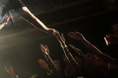 Free Singer Shakes Hands With Fans During A Concert Stock Photo - 173169200