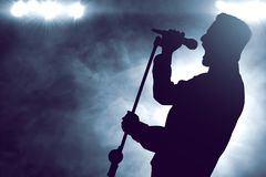Singer singing silhouette on the stage. Singer sing silhouette on the stage stock photo