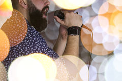 Singer singing stage light. Close-up portrait of a handsome bearded man posing on camera Stock Image
