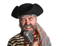 Singer sings in an old microphone. Singer dressed as sea pirate sings in an old microphone Stock Image
