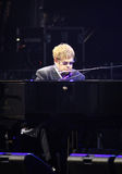 Singer Sir Elton John performs onstage. KYIV, UKRAINE - JUNE 30, 2012: Singer Sir Elton John performs onstage during charity Anti-AIDS concert at the Stock Photos