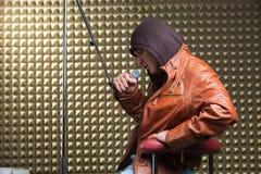 Singer sitting in recording studio Stock Photos