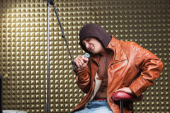 Singer sitting in recording studio Royalty Free Stock Photos